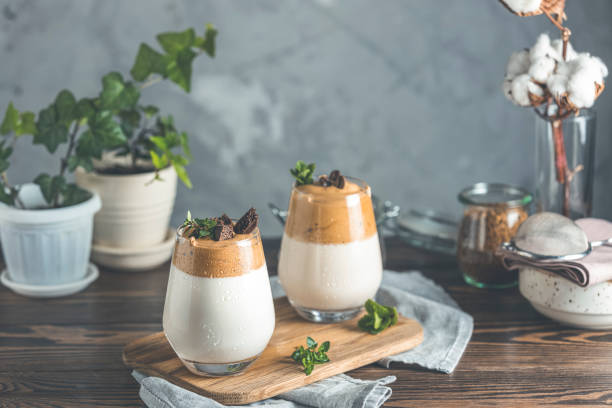 Two glasses of Iced Dalgona Coffee, a trendy fluffy creamy whipped coffee stock photo