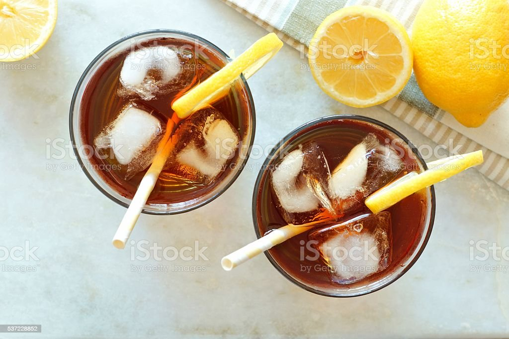 Two glasses of iced tea, overhead view on marble stock photo