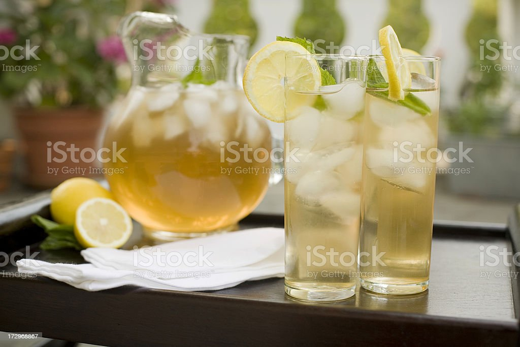 Two glasses of iced tea with lemons outdoors royalty-free stock photo