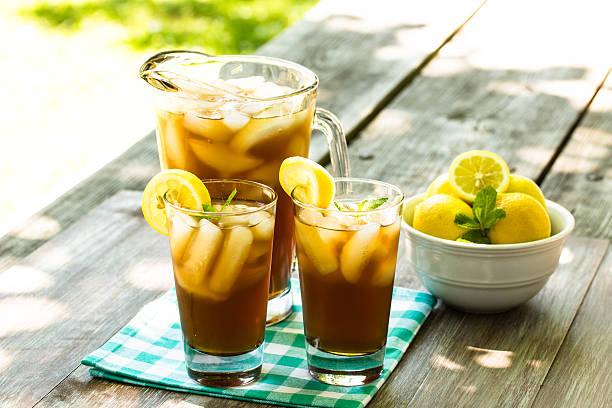 Two Glasses of Iced Tea With Lemons stock photo