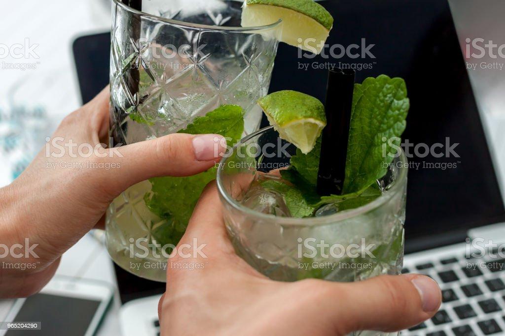 two glasses of mojito on laptop background zbiór zdjęć royalty-free