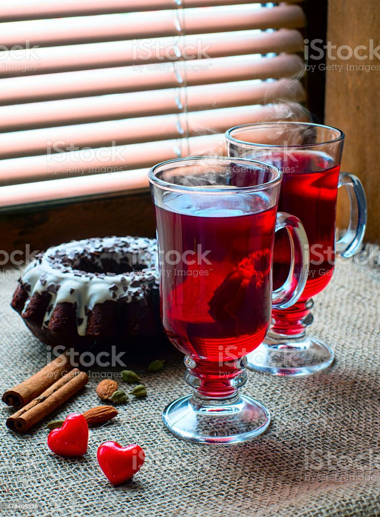 two glasses of mulled wine with red hearts stock photo