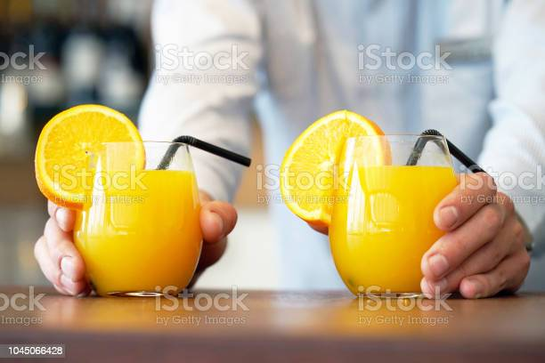 Two glasses of orange juice picture id1045066428?b=1&k=6&m=1045066428&s=612x612&h=gf8wdgow21nh16z9k05ie ptmjjre1oelsdwjgui2uk=