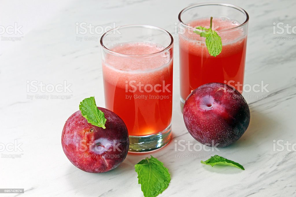 Two glasses of plum juices stock photo