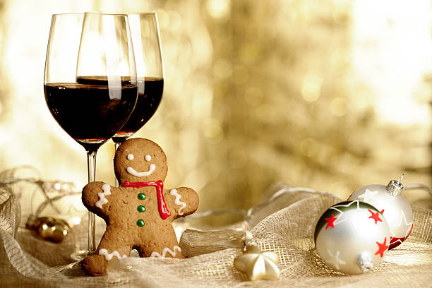 Two glasses of Red Wine, Gingerbread Man and Christmas Ornaments stock photo