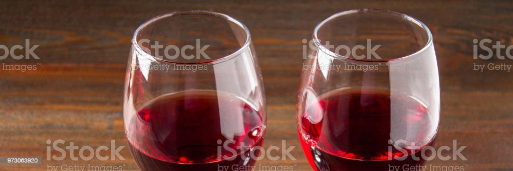 Two Glasses Of Red Wine On A Brown Wooden Table Alcoholic Beverages Banner Stock Photo Download Image Now Istock
