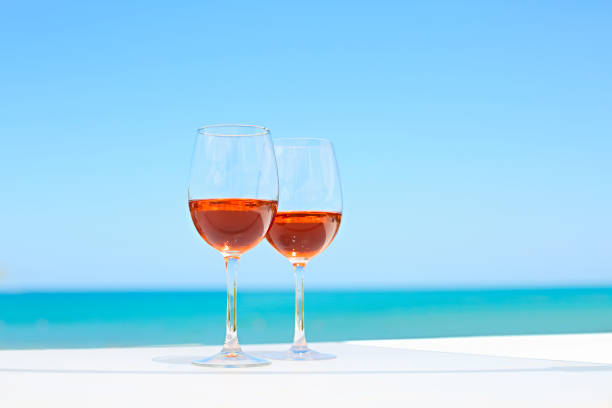 Two glasses of rose wine against blue water and sea picture id1205594960?b=1&k=6&m=1205594960&s=612x612&w=0&h=10eywub xcbs4ookcxdv4ahbvwox4pe ewajg9mknwk=