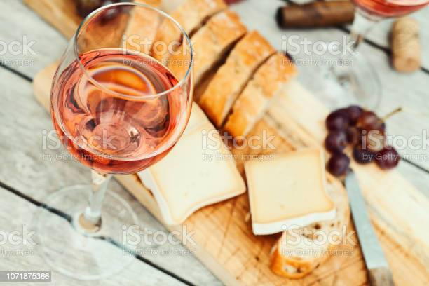 Two glasses of rose wine and board with fruits bread and cheese on picture id1071875366?b=1&k=6&m=1071875366&s=612x612&h=etxr wlfou6mmnjtvijahljg8zvo7ifshcuwbfnmpqk=