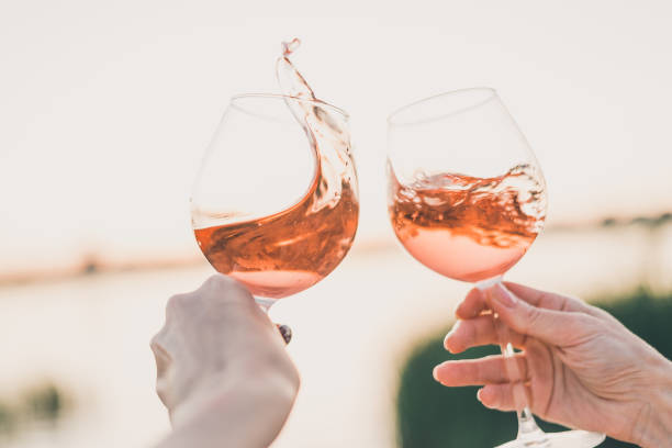 Two glasses of rose wine in hands against the sunset sky picture id1155903612?b=1&k=6&m=1155903612&s=612x612&w=0&h=pyzaj9kbnqtltkyudgtgt5yyb4m8ufr4 369njh4yqm=