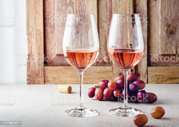 Photo of Two glasses of rose wine.