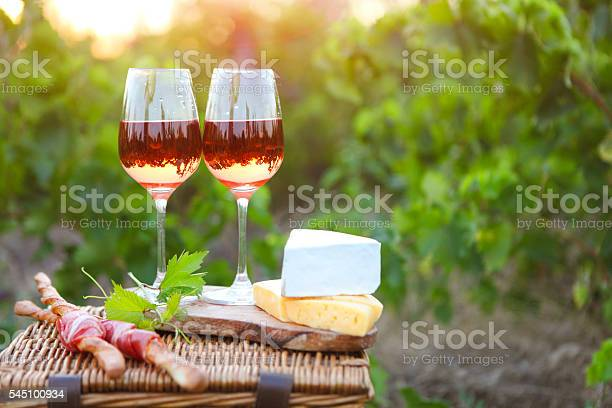Two glasses of rose wine with bread meat grape cheese picture id545100934?b=1&k=6&m=545100934&s=612x612&h=rm24iwcwuz42l8gy4egdaugywnu90vcnognnjacr7nw=