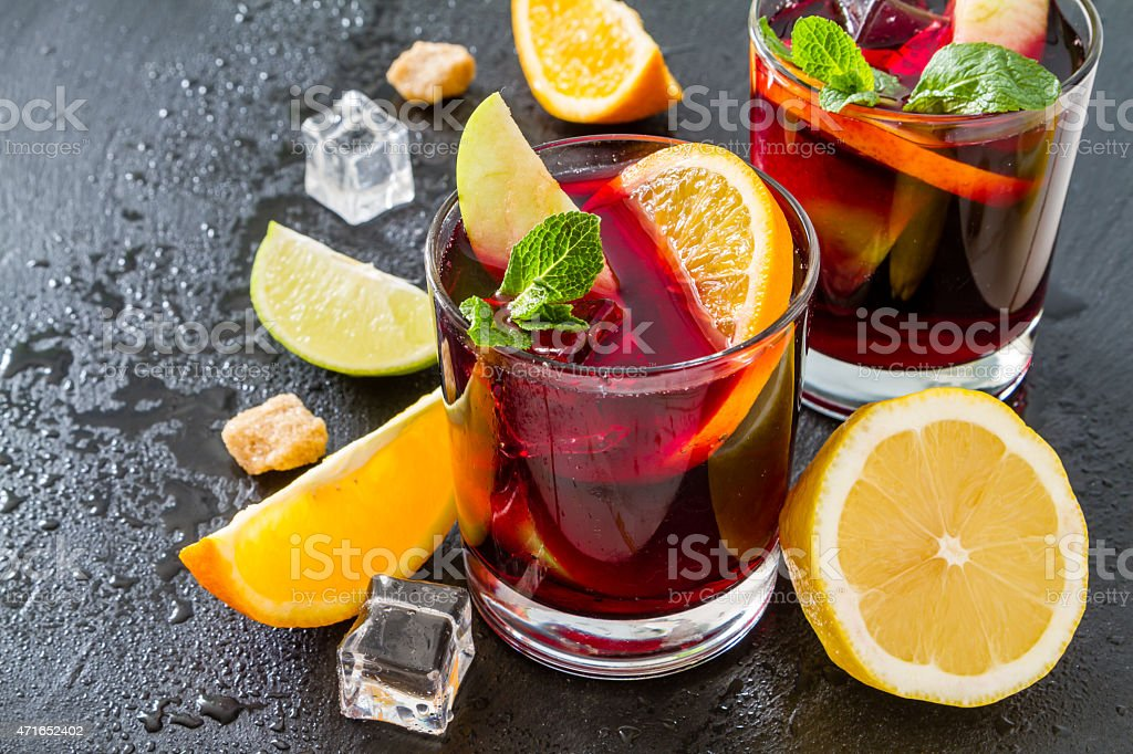 Two glasses of sangria with lemon slices and ice stock photo