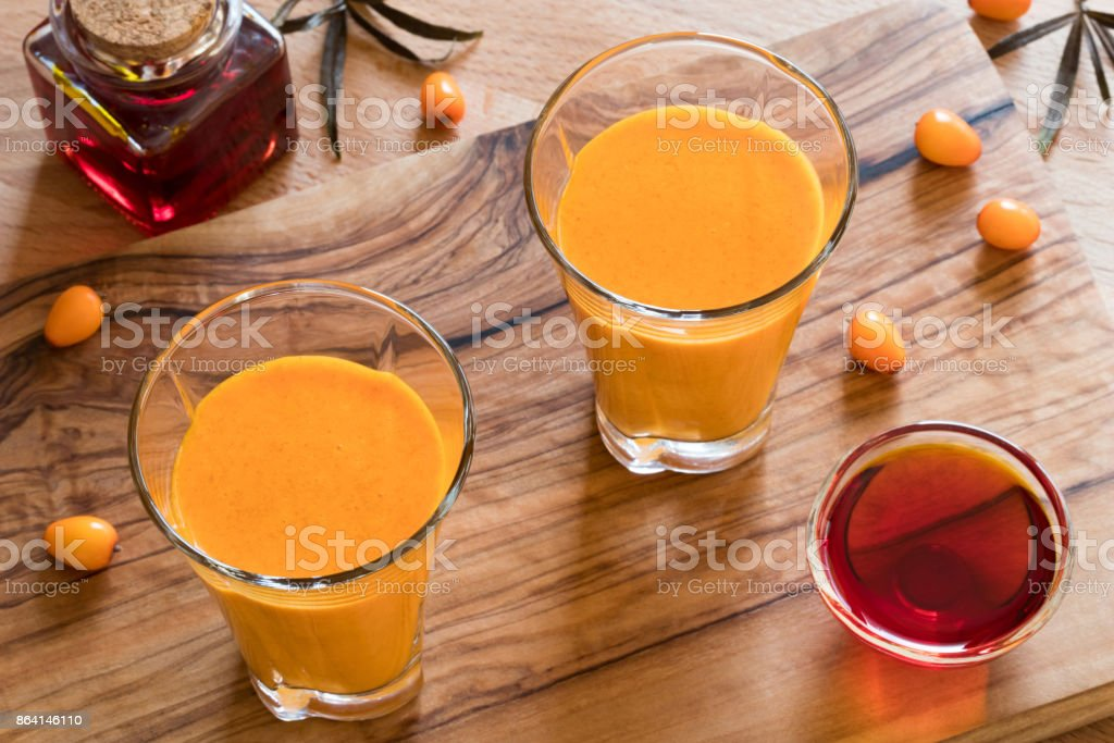 Two glasses of sea buckthorn juice royalty-free stock photo