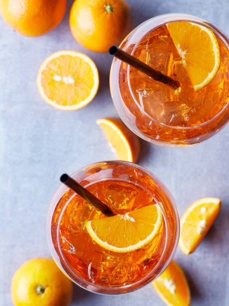 Two glasses of Spritz cocktail Two glasses of Spritz cocktail with orange slices on marble background. Top view spraying stock pictures, royalty-free photos & images