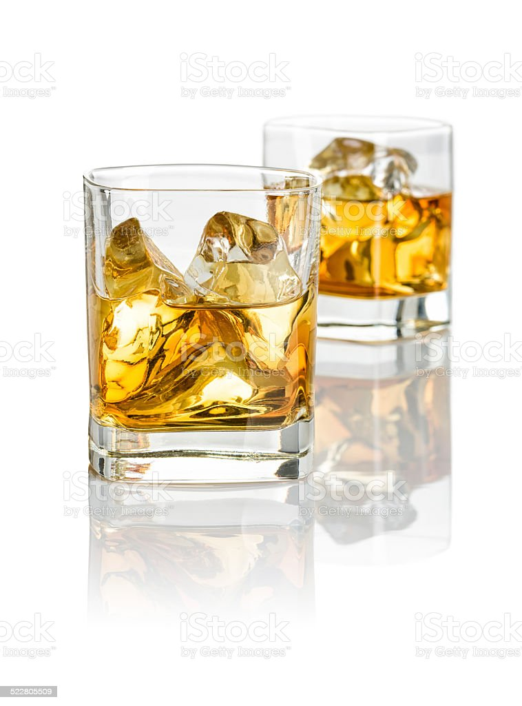 Two glasses of whiskey stock photo