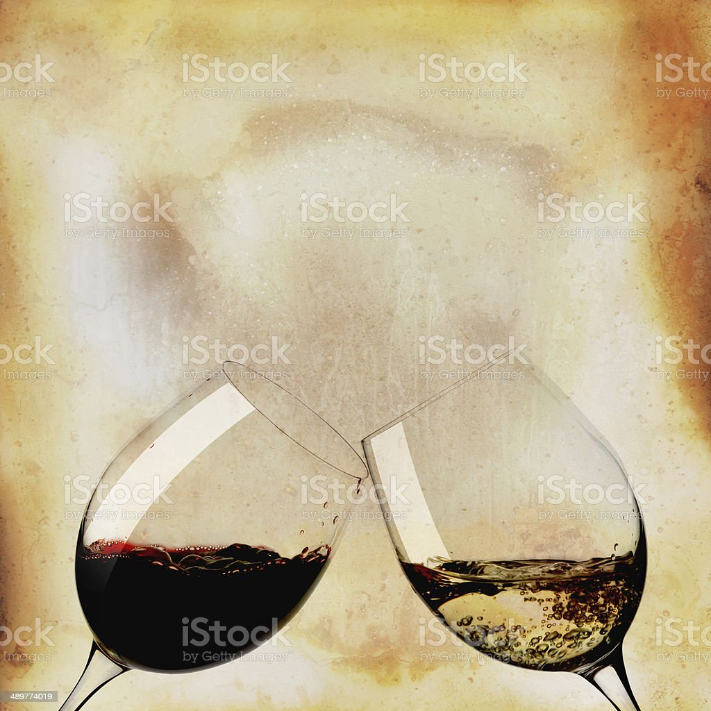Two glasses of white wine and black stock photo