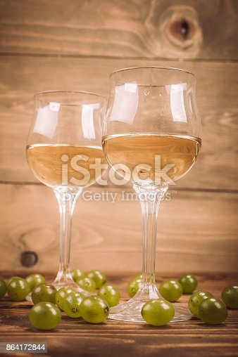 Two Glasses Of White Wine And Grapes On Wooden Table Stock Photo & More Pictures of Aging Process