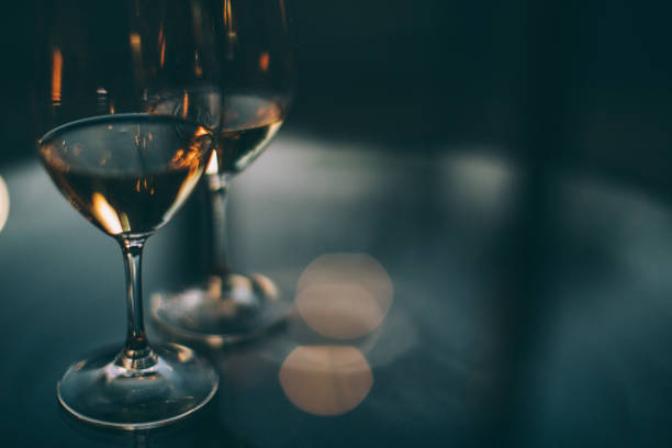 Two glasses of white wine on a table stock photo