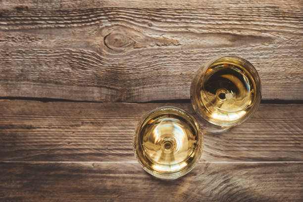 Two glasses of white wine Two glasses of white wine on the wooden background white wine stock pictures, royalty-free photos & images
