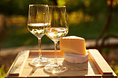 istock Two glasses of white wine with cheese 625305246