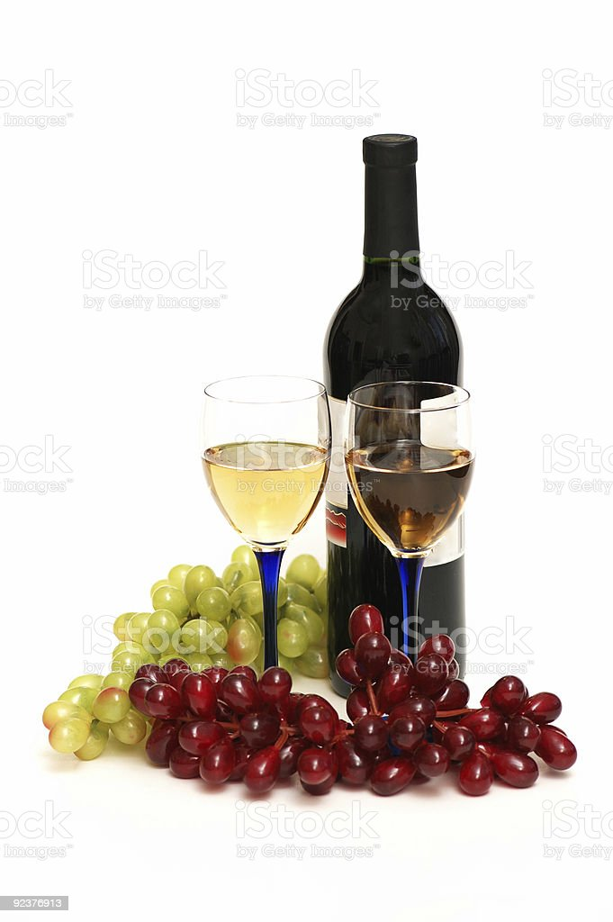 Two glasses of wine, bottle and grapes isolated  on white royalty-free stock photo