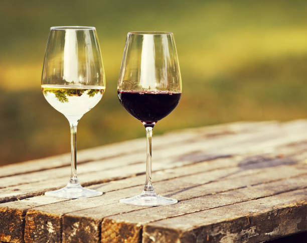 Two glasses of wine, red wine and white wine outdoor stock photo