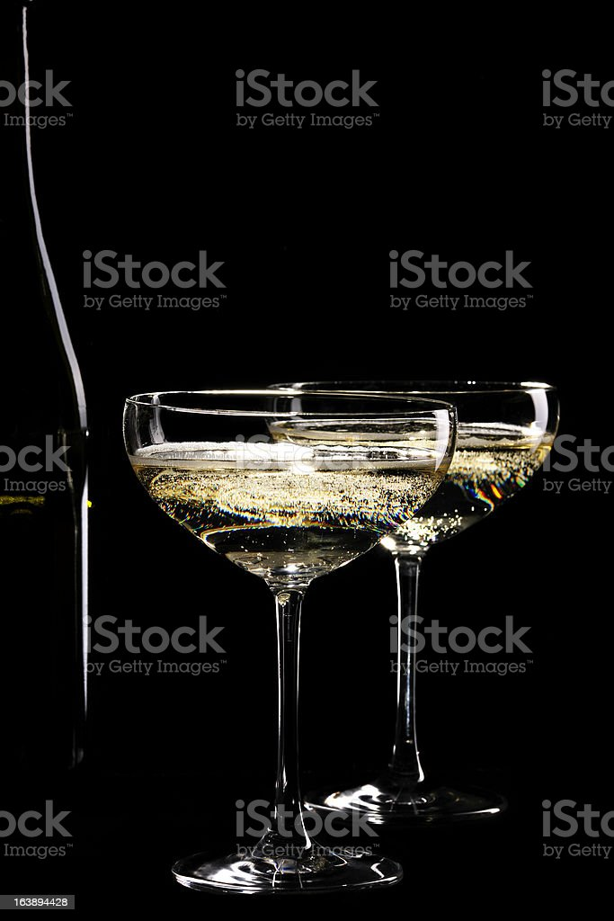 Two glasses sparkling champagne infront of black background stock photo