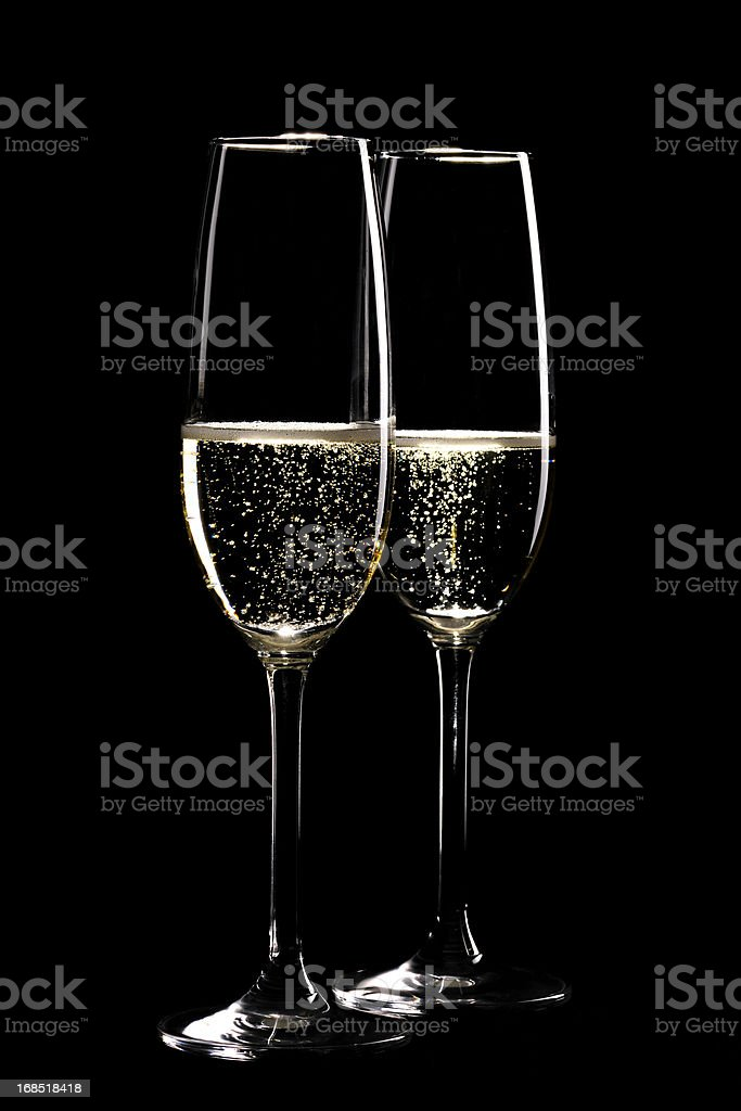 Two glasses sparkling champagne infront of black stock photo
