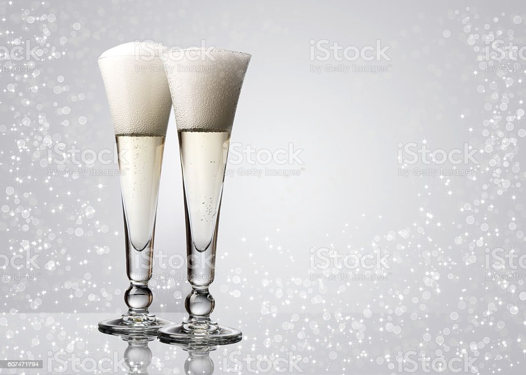 Two glasses with champagne on grey background. stock photo
