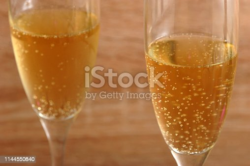 istock Two glasses with champagne. 1144550840