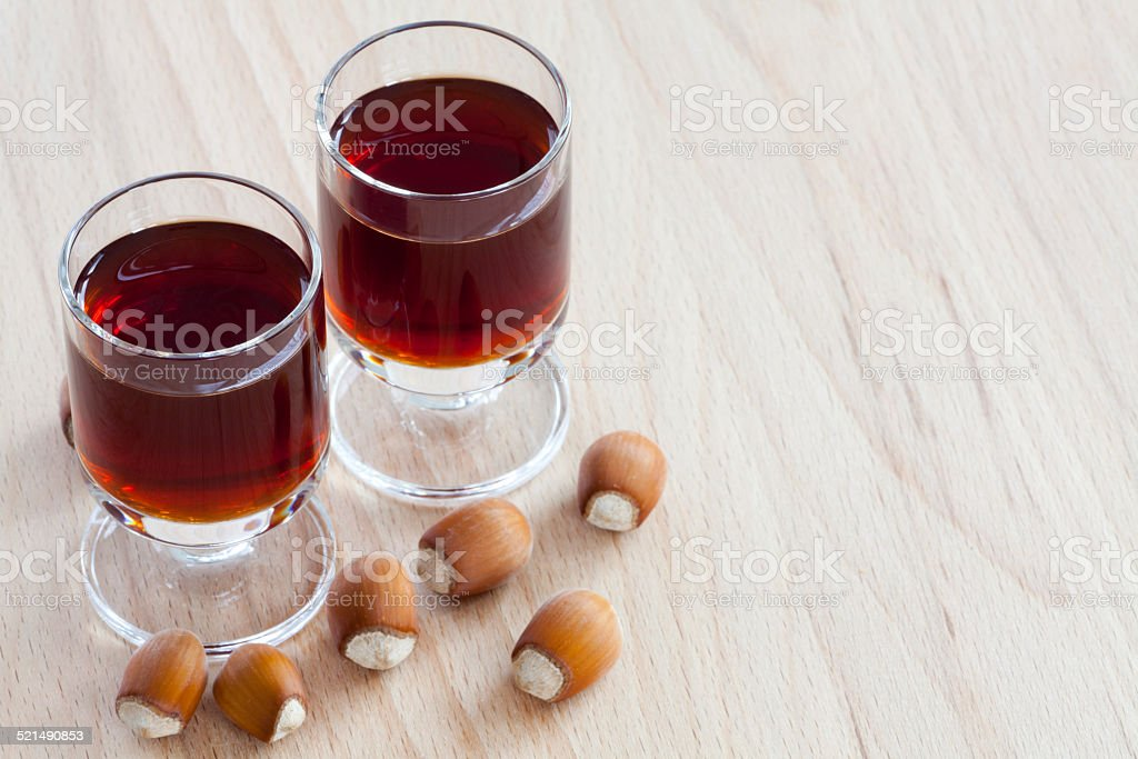 Two glasses with hazelnut liqueur stock photo