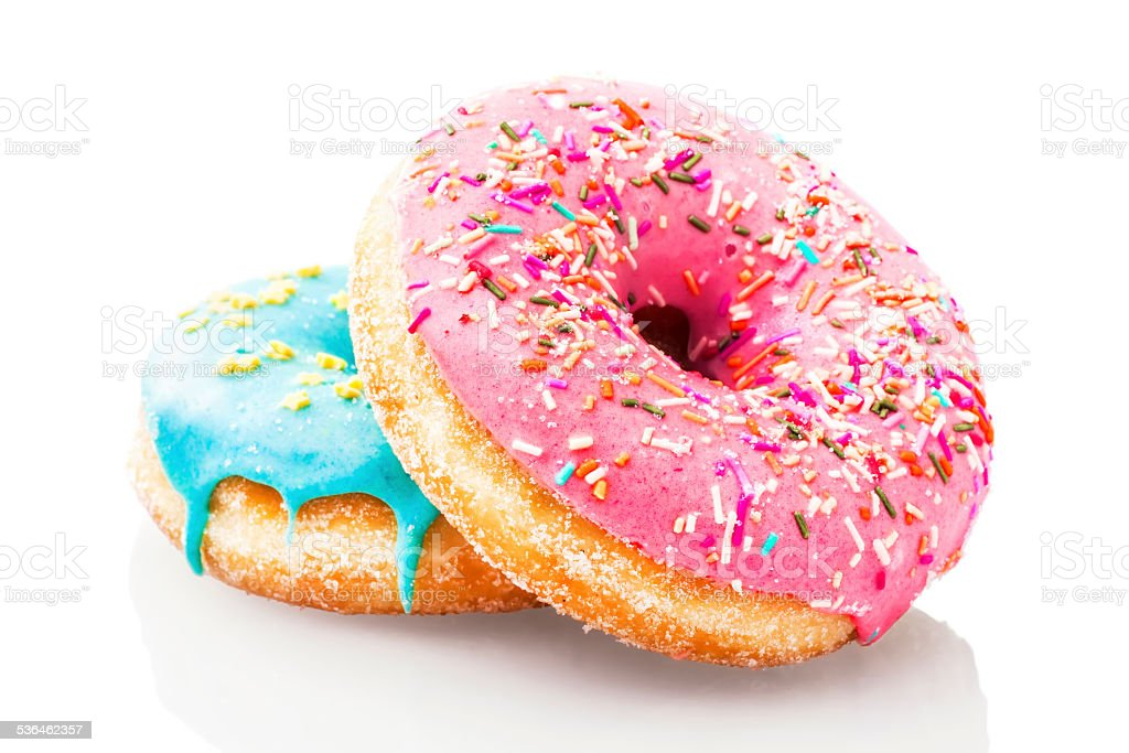 Two glazed donuts isolated on white background stock photo