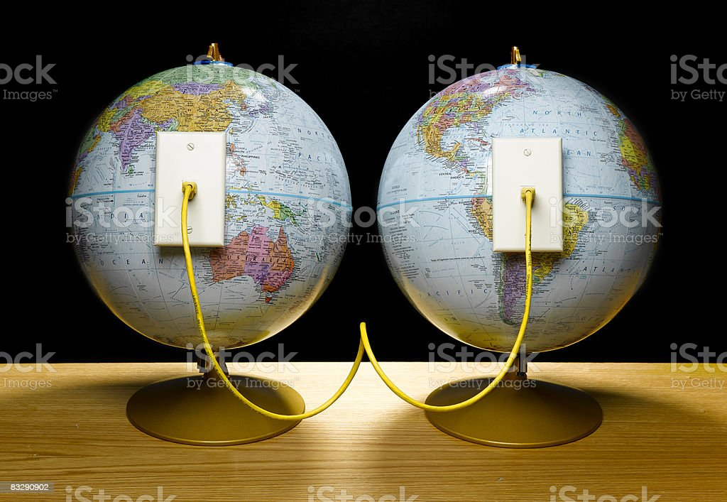Two globes connected by ethernet cable - Royalty-free Black Background Stock Photo