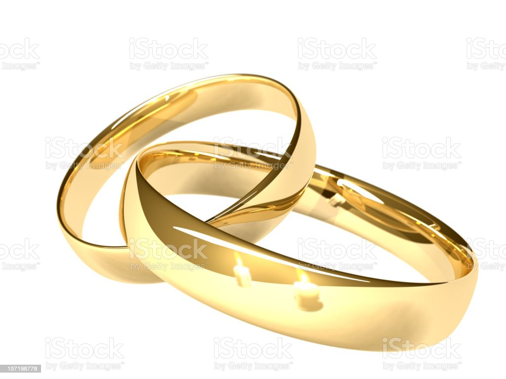 Two gold wedding rings - reflected candles royalty-free stock photo