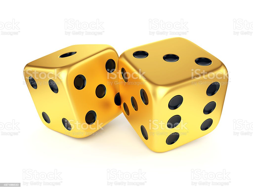 Two golden dices stock photo