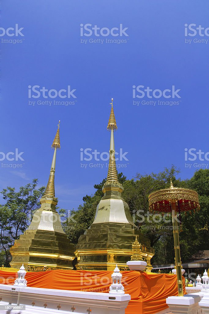 Two golden pagodas in Phra That Doi Tung temple, royalty-free stock photo