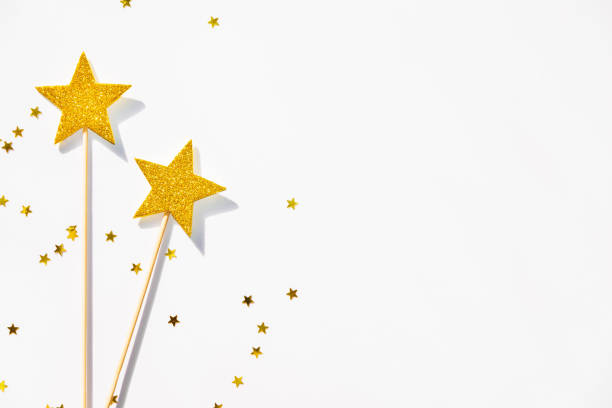 two golden party magic wands and sequins on a white background. copy space. - fairy wand stock photos and pictures