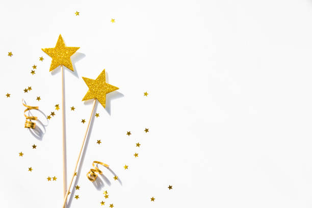 two golden party magic wands, sequins and ribbons on a white background. copy space. - fairy wand stock photos and pictures