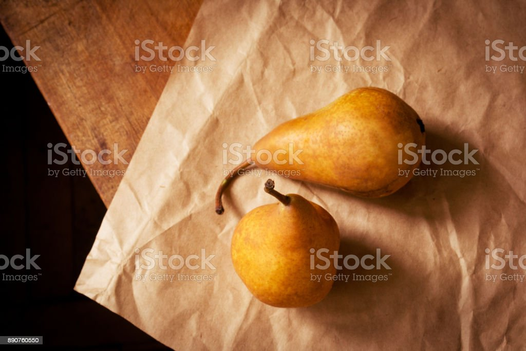 Two golden pears stock photo