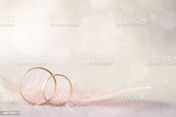 Two golden wedding rings and feather light soft background picture id486759324?b=1&k=6&m=486759324&s=612x612&h=qf571r1n ziofatmchibu1ejf kq1y1sgkd3togdbm0=