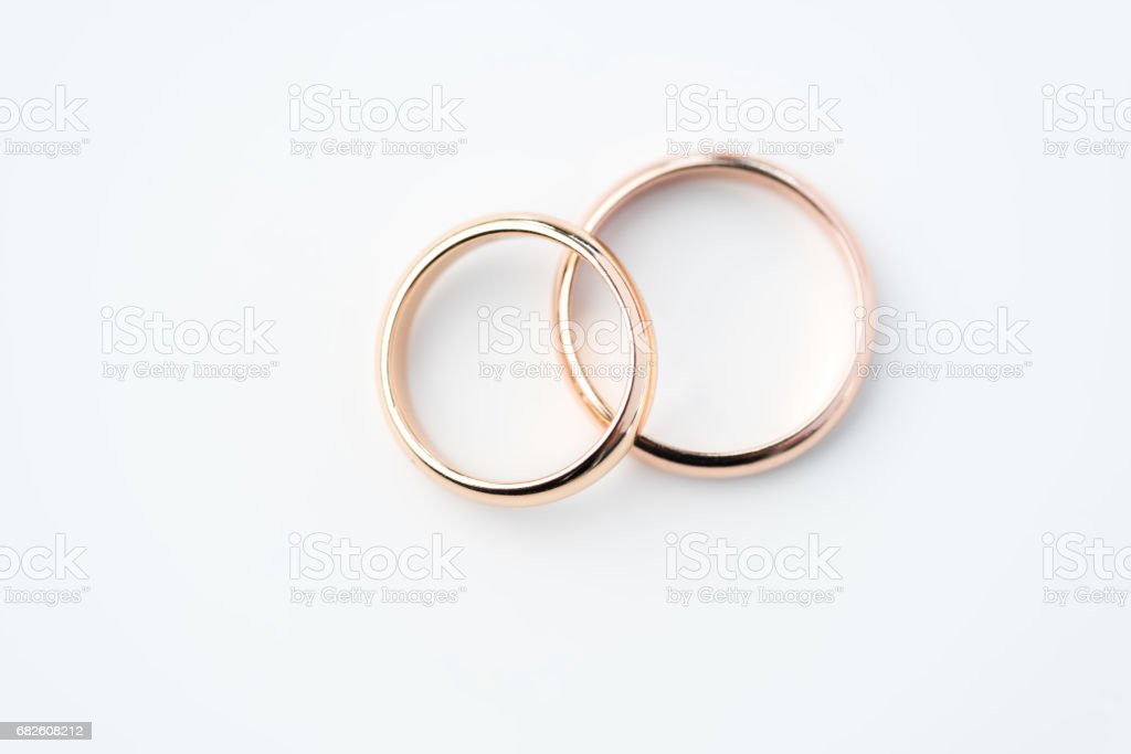 two golden wedding rings isolated on white, wedding rings background concept stock photo