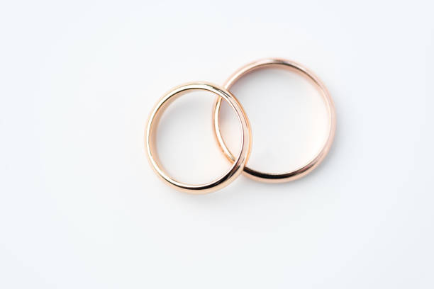 two golden wedding rings isolated on white, wedding rings background concept - foto de acervo