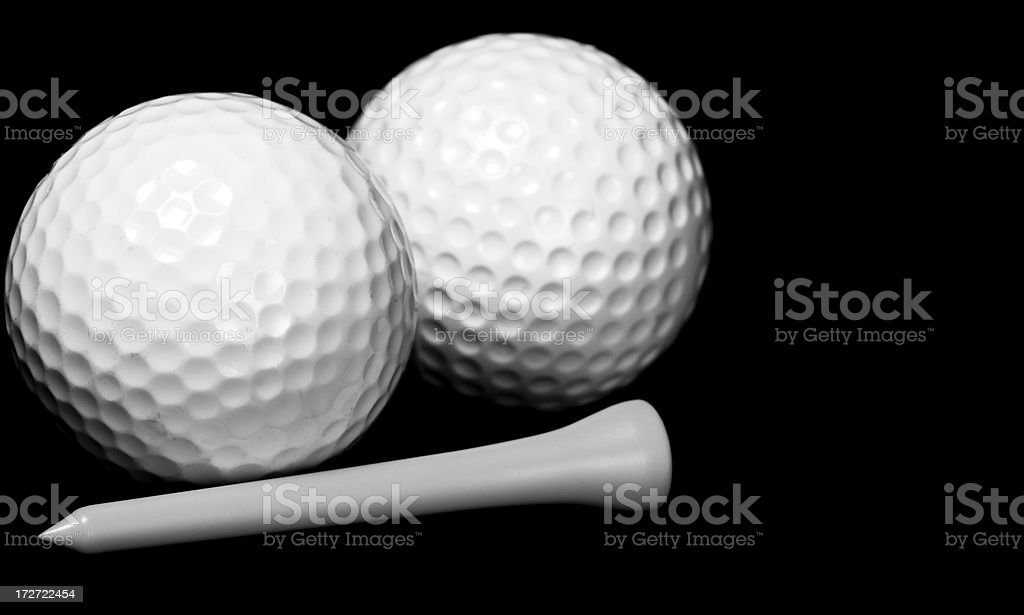Two Golf Balls and a Tee royalty-free stock photo