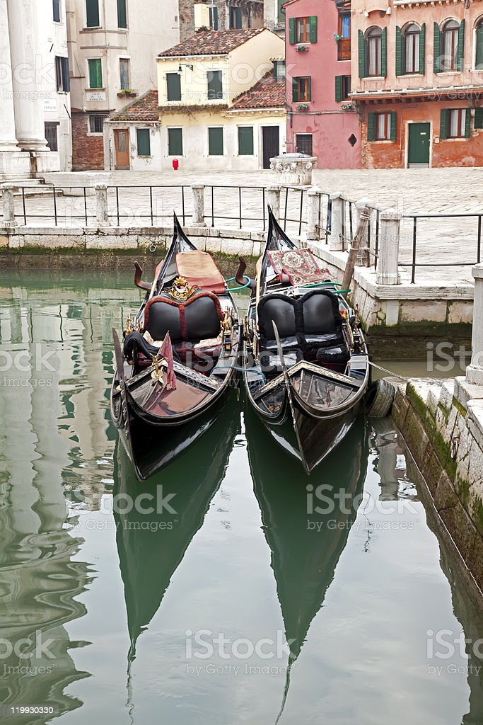 Two gondola in Venice at the pier royalty-free stock photo