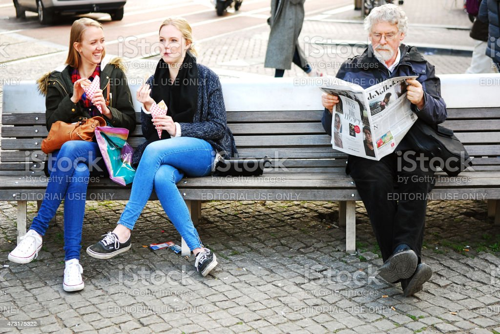 Two good Friends eating Potato Chips. stock photo