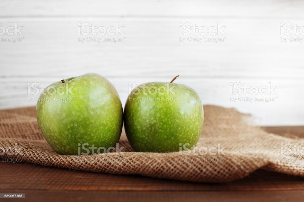 Two green apples on a sacking. The concept of healthy eating and vegetarianism. royalty-free stock photo
