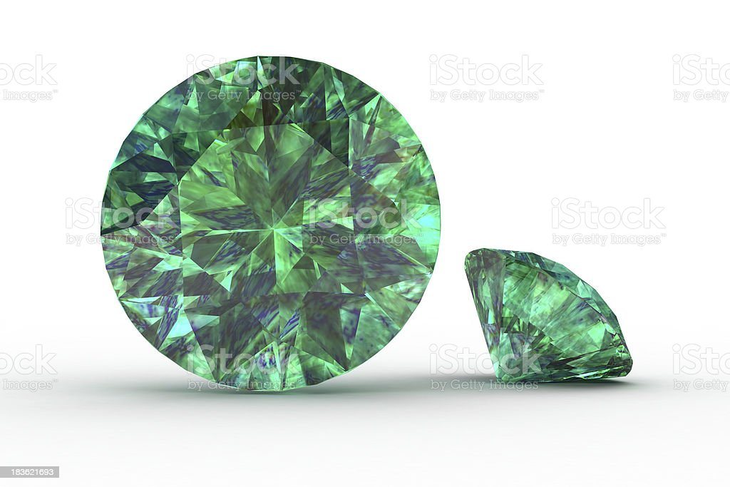 Two green emerald jewels sat on white stock photo