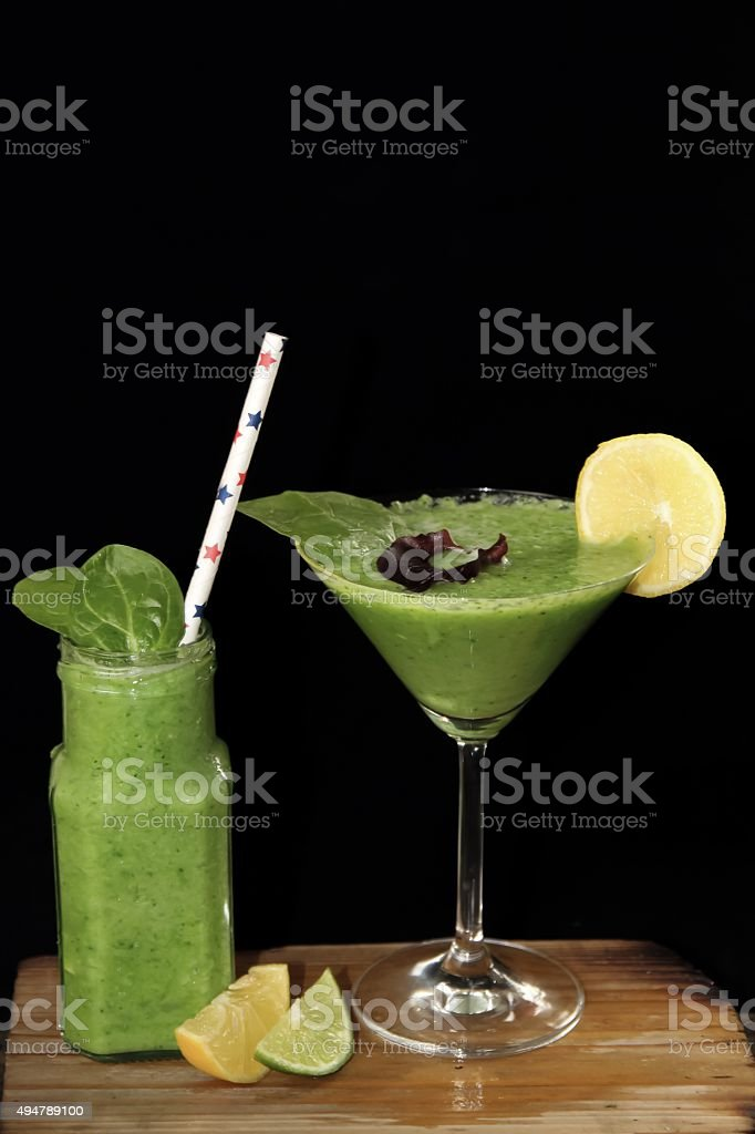 Two green healthy vegetable smoothies stock photo