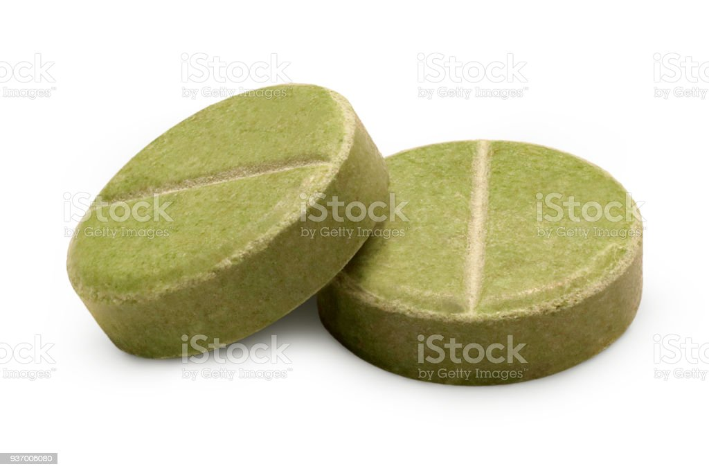 Two green herbal pills close-up stock photo