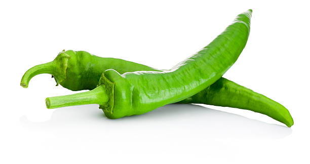 two green hot peppers isolated on white background - green chilli pepper stock photos and pictures